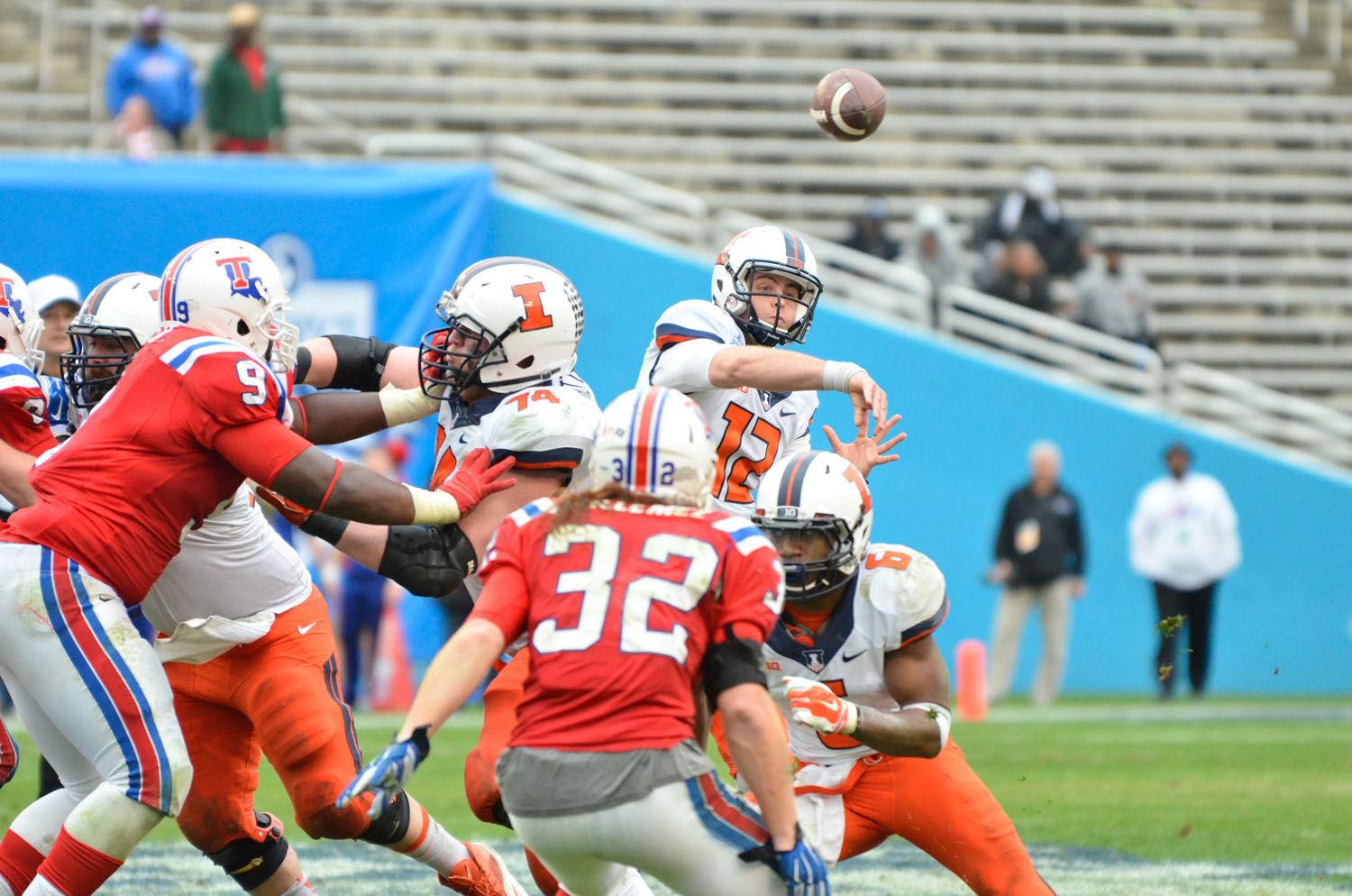 Illinois' Wes Lunt (12) passes the ball during the Zaxby's Heart of Dallas Bowl against Louisiana Tech at Cotton Bowl Stadium in Dallas, Texas on Friday, Dec. 26, 2014. The Illini lost 35-18.