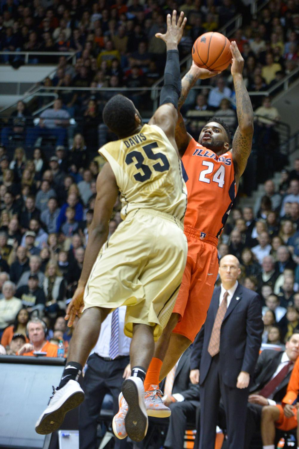 Illinois' Rayvonte Rice (24) rises for a jump shot during the game against Purdue at Mackey Arena in West Lafayette, Indiana, on Saturday. The Illini lost 63-58.