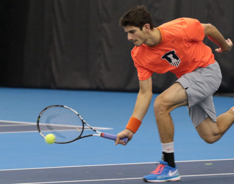 Illinois' Jared Hiltzik attempts to save a short ball during the tennis game vs. Northwestern at Atkins Tennis Center on Feb. 20. Hiltzik won twice on Saturday — once against Valparaiso and once against Notre Dame.