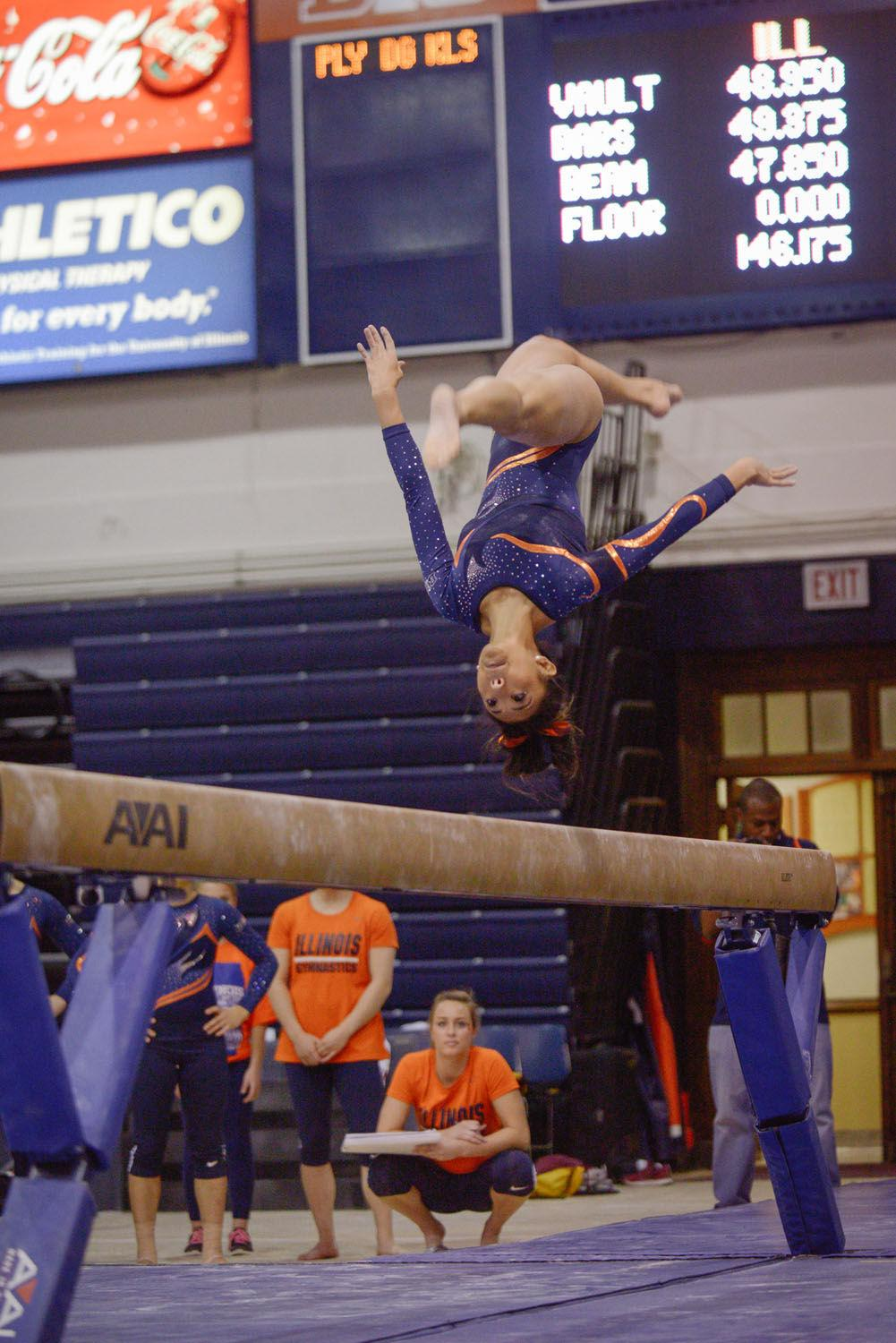 Illinois' Sunny Kato performs a routine on the balance beam during the meet against Minnesota at Huff Hall on Feb. 7.