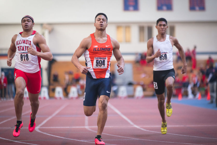 Illinois%E2%80%99+Watkins+Maurice+keeps+his+lead+against+his+opponents+during+the+Men%E2%80%99s+400+Meter+Dash+event+at+the+Orange+%26amp%3B+Blue+meet+at+the+Armory+on+Feb.+21.+Illinois%E2%80%99+men%E2%80%99s+team+won+1st+place+out+of+4.