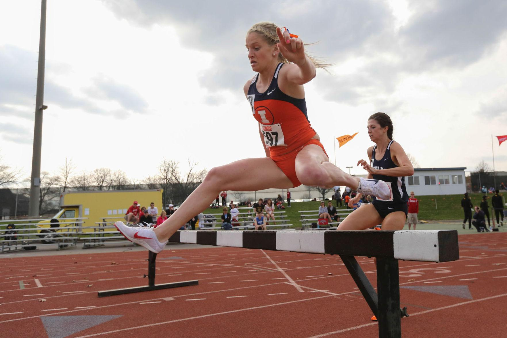 Illinois' Britten Petrey runs the 3000 meter Steeplechase during the Illinois Twilight Track and Field meet at Illinois Soccer and Track Stadium, on Saturday, April 12, 2014.