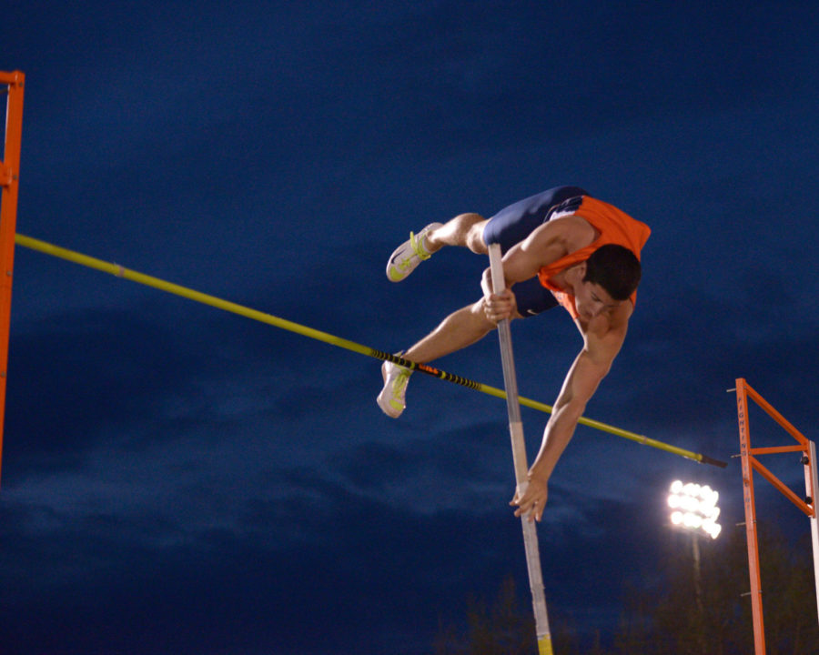 Illinois' George Wanda attempts to pass the bar during the pole vault event at the Illinois Twilight Meet on the Illinois Soccer and Track Stadium on Saturday, April 18.
