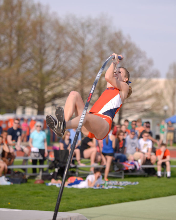 Illinois' Stephanie Richartz propells herself into the air during the pole vault event at the Illinois Twilight meet on Saturday.