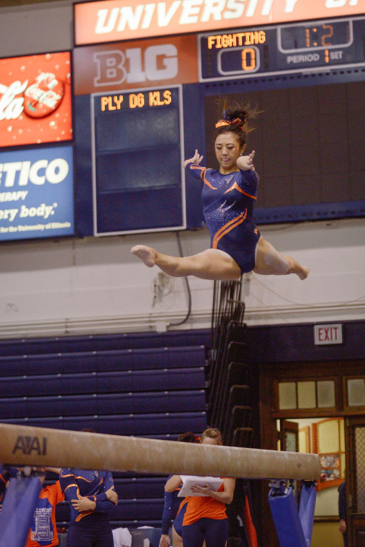 Illinois' Sunny Kato performs a routine on the balance beam during the meet against Minnesota at Huff Hall on Saturday, February 7, 2015. The Illini won 195.775-195.375.