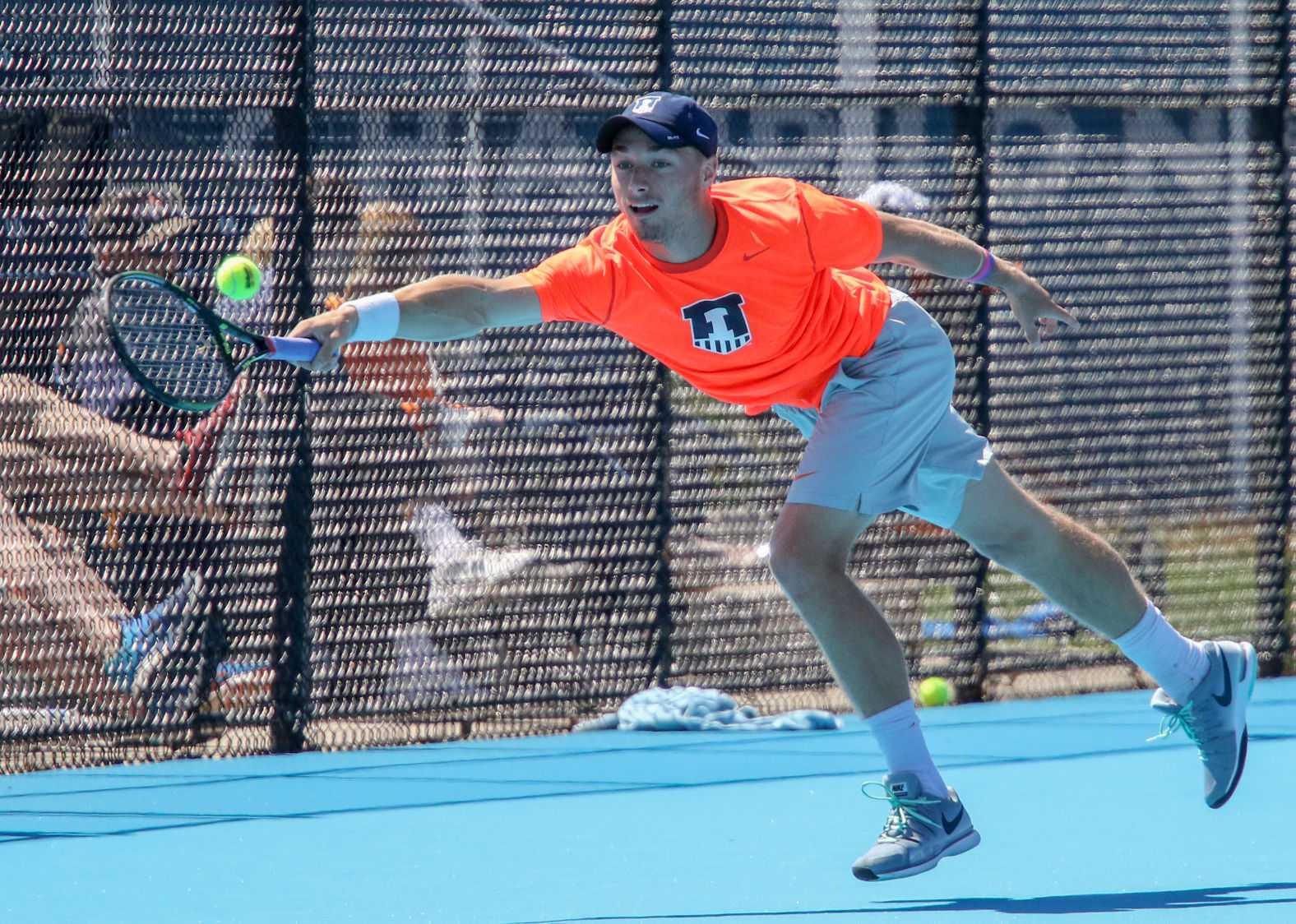 Illinois' Tim Kopinski reaches for the ball during the tennis game v. Iowa at Atkins Tennis Center on Saturday, April 11. Illinois won 6-1.