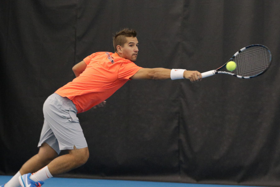 Illinois' Blake Bazarnik reaches for the ball in an attempt to save it during the tennis game vs. Northwestern at Atkins Tennis Center on Feb. 20.
