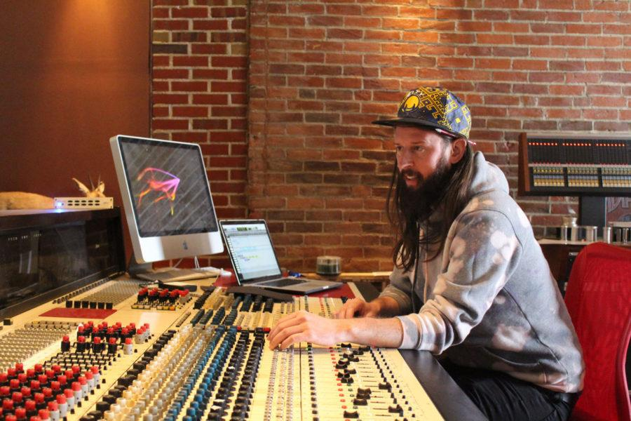 James Treichler, drummer and audio engineer of Elsinore, works at a sound board for day one of recording the band's new album.
