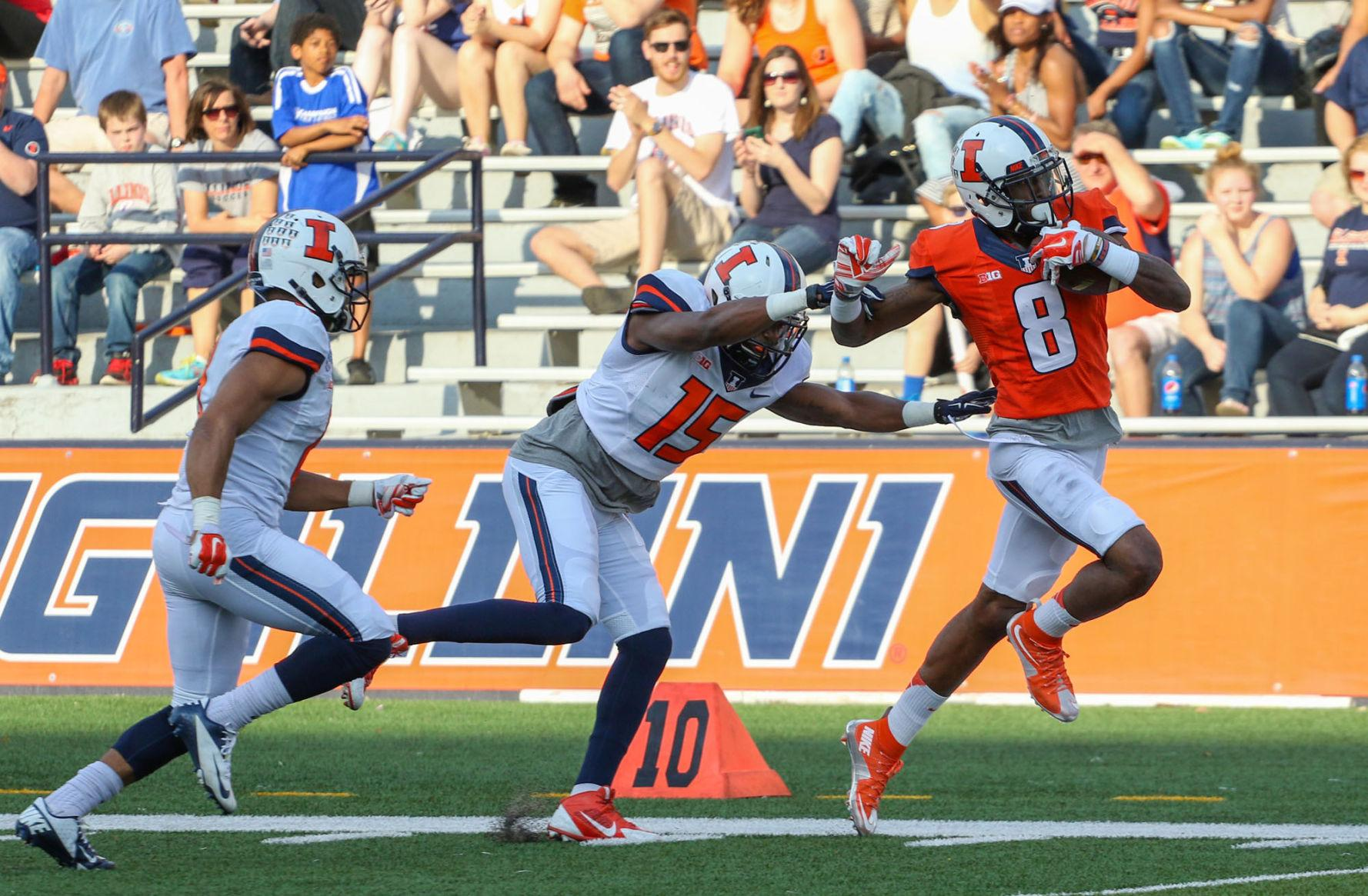 Illinois' Geronimo Allison attempts to outrun Jevaris Little and Dillan Cazley during the annual football Spring Game at Memorial Stadium on Saturday. The Orange won 44-41.