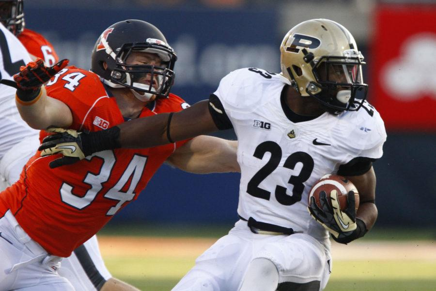 Illinois' Mike Svetina looks to tackle Purdue's Ralph Bolden during the game at Memorial Stadium on Nov. 17, 2012.