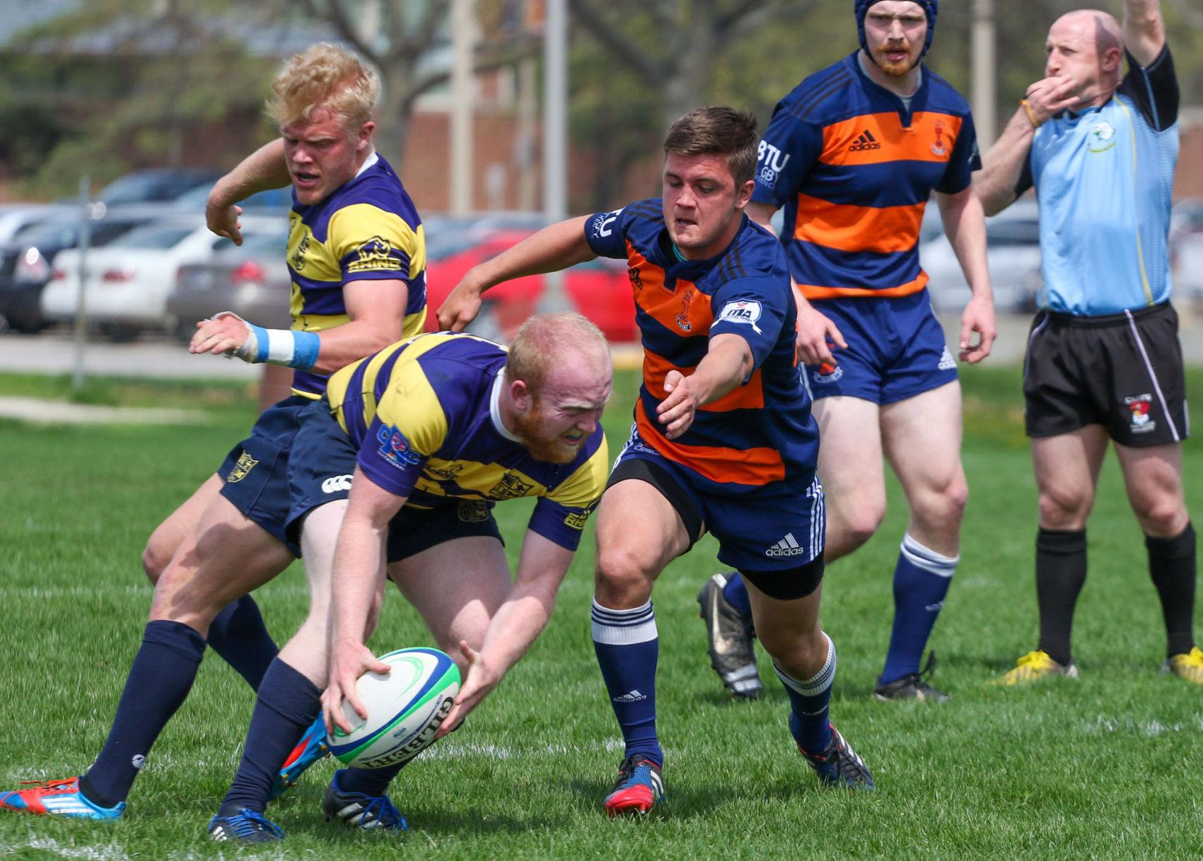 Illinois' Joe Bird goes after Michigan's offense during the Big Ten Rugby Tournament v. Michigan at the Complex Fields on Saturday.