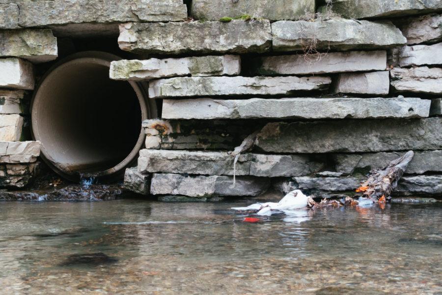 A plastic bag lies in Boneyard Creek on Apr. 13, 2015