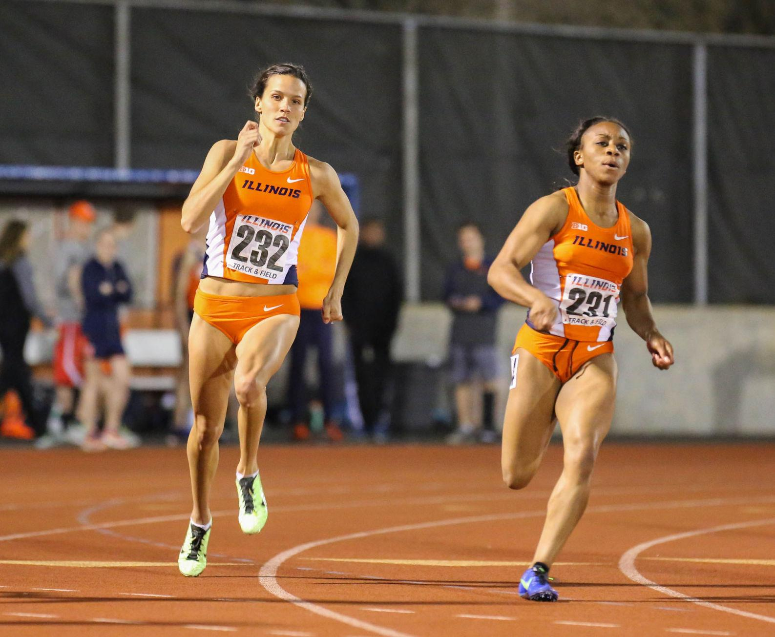Illinois' Amanda Duvendak (232) runs the 200 meter dash during the Illinois Twilight Invitational at the Track and Soccer Stadium on Saturday, April 18.