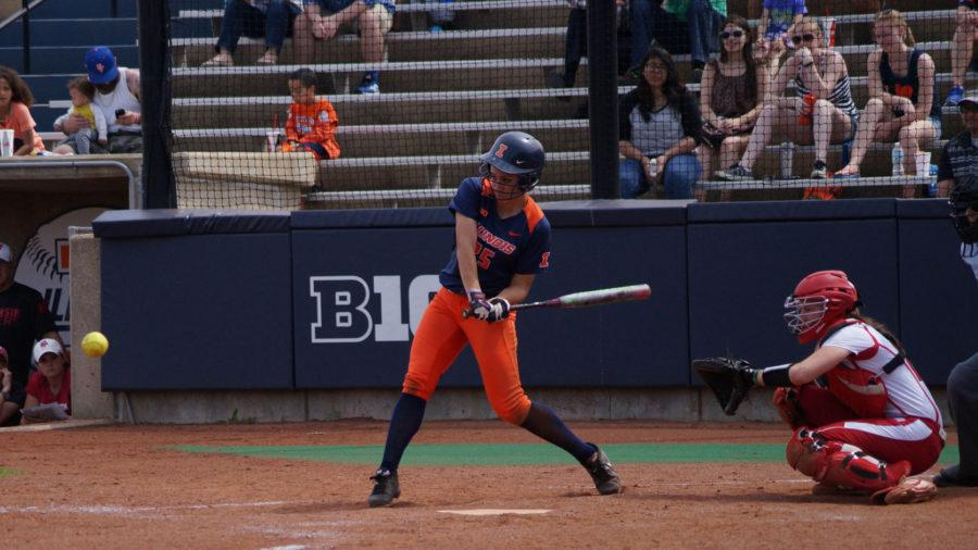 Illinois' Carly Thomas swings for the ball during the team's 5-3 win against Wisconsin at Eichelberger Field on Saturday.