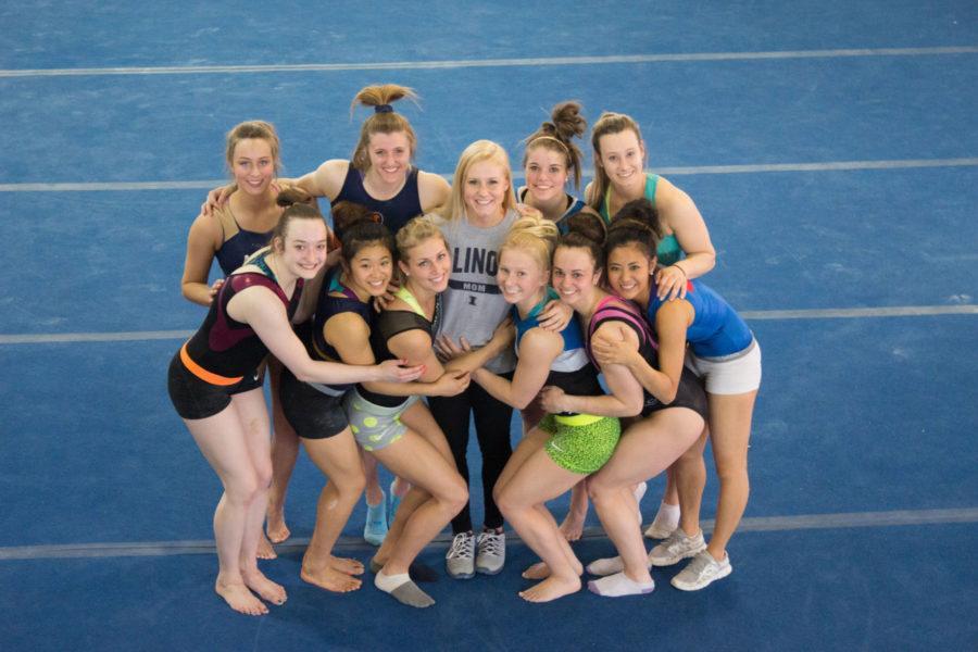 Senior+Gymnast+Jordan+Naleway%2C+the+%22mom%22+of+the+women%27s+gymnastic+team%2C+is+hugged+by+her+teammates+to+celebrate+her+final+year+in+team.