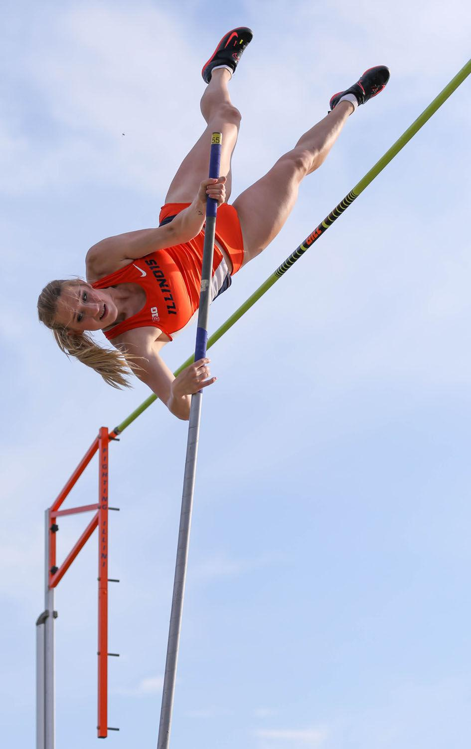 Illinois' pole vaulter Jennifer DeBellis attempts to clear the bar during the Illinois Twilight invite at The Illinois Track and Soccer Stadium on April 18.