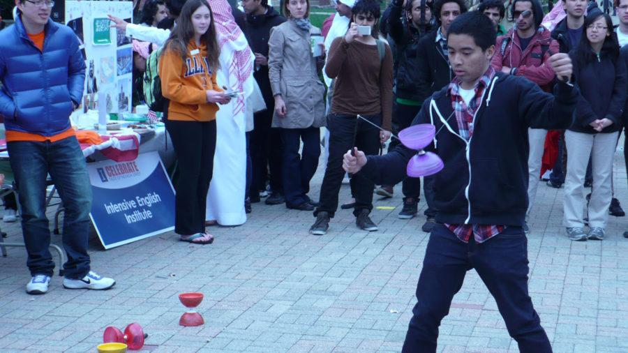 A Taiwanese American Student Club member captivates onlookers as he performs with a Chinese yo-yo during the 2013 International Week's Travel Around the World event.
