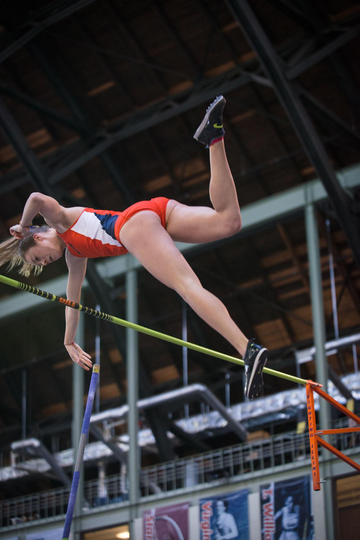 Illinois' Stephanie Richartz releases the pole as she lifts past the bar to break her previous record with a height of 4.38 meters.