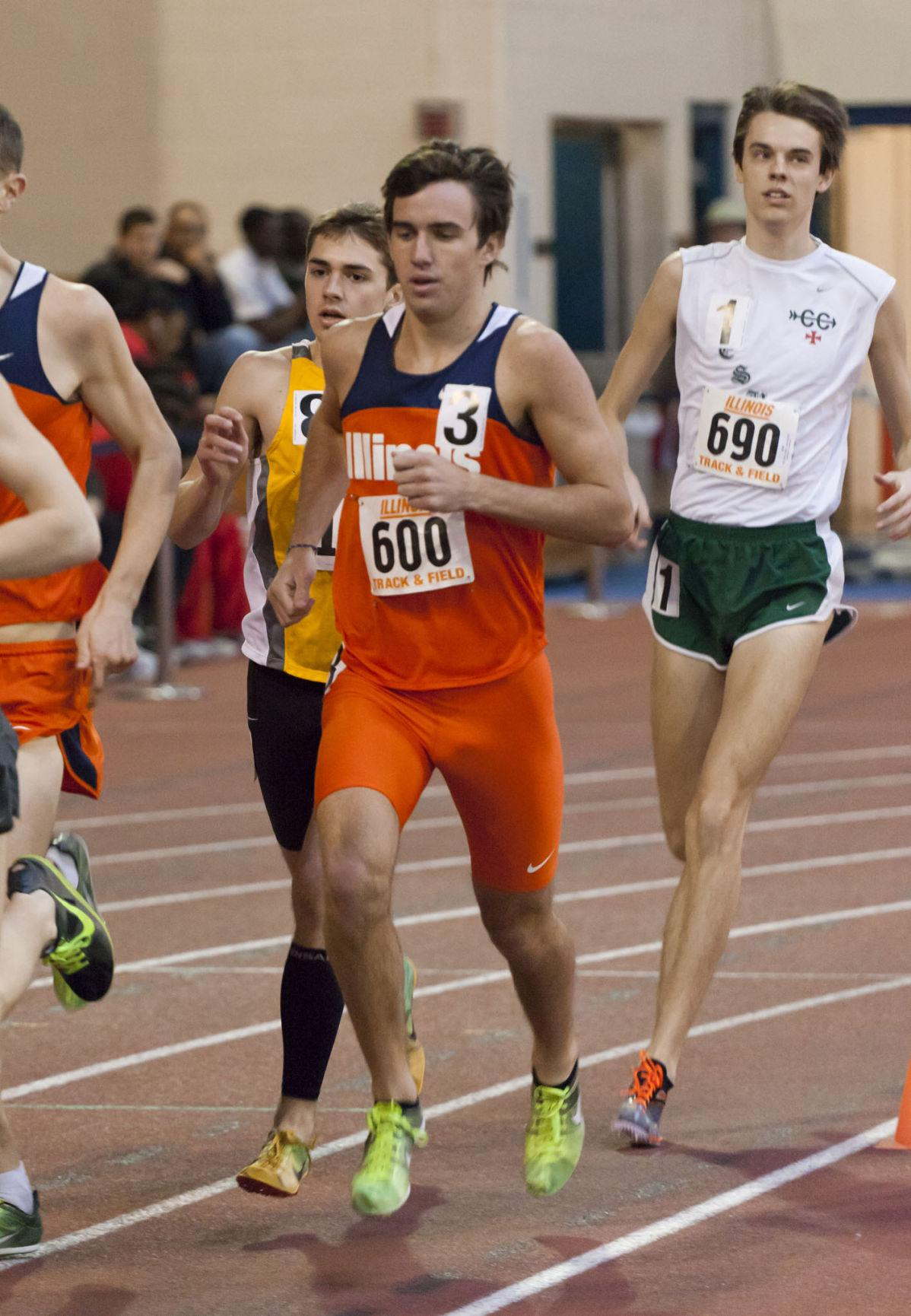 Joe McAsey (600) runs in the 1 Mile Event during the Orange and Blue Open at the Armory on Saturday Feb. 4, 2012.