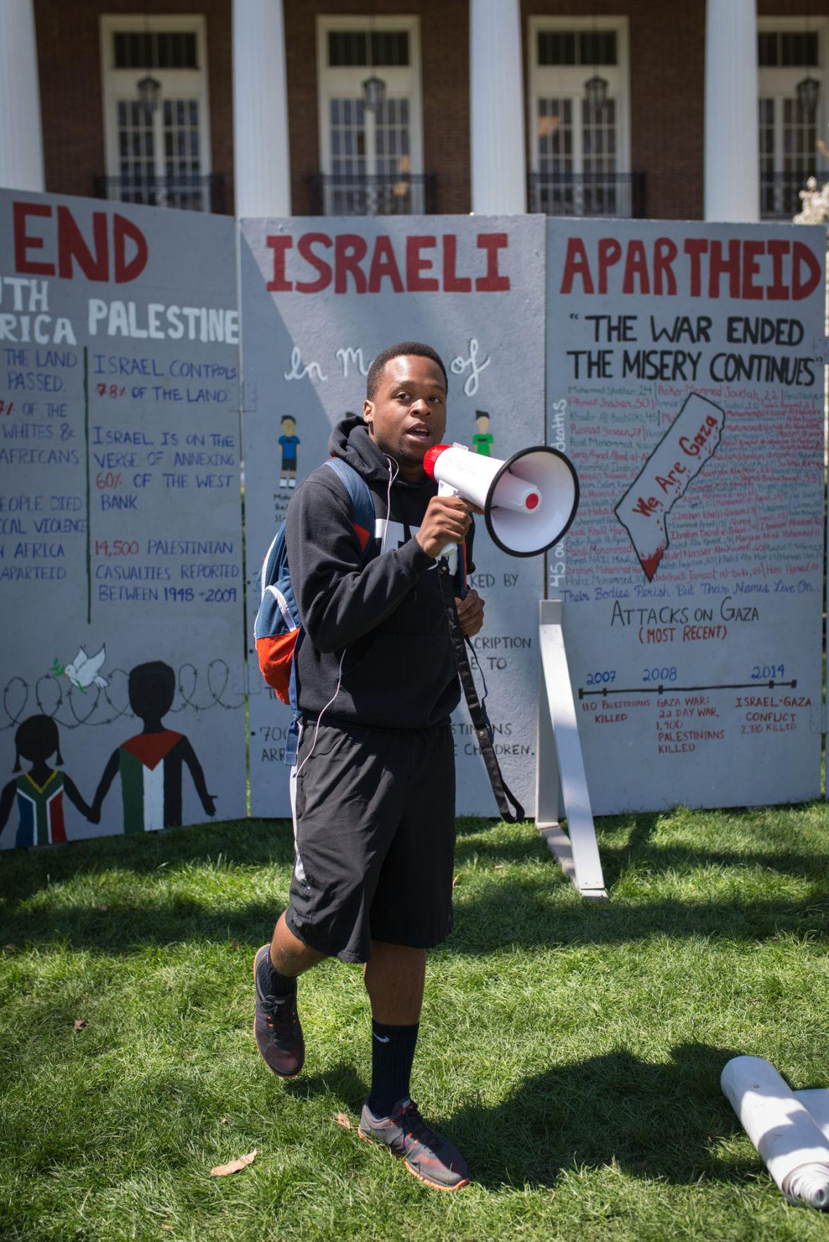 Zaid Hameed, junior in LAS, speaks about Israeli Apartheid in front of the English building at the Main Quad Tuesday.