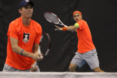 Illinois' Aron Hiltzik attempts a return during the tennis game vs. Ohio State at Atkins Tennis Center on March 29. Illinois looks to continue flawless play this weekend.