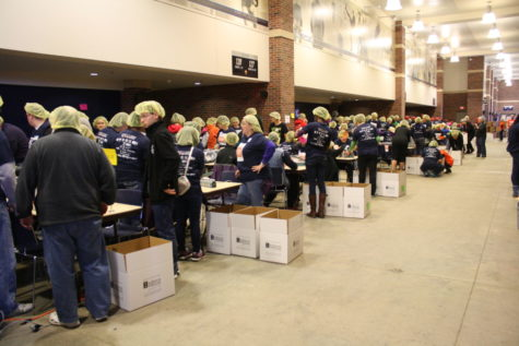 Volunteers help work the packaging lines for Illini Fighting Hunger. The organization is preparing to package 148,000 meal for Saturday's Community & Campus Day of Service.