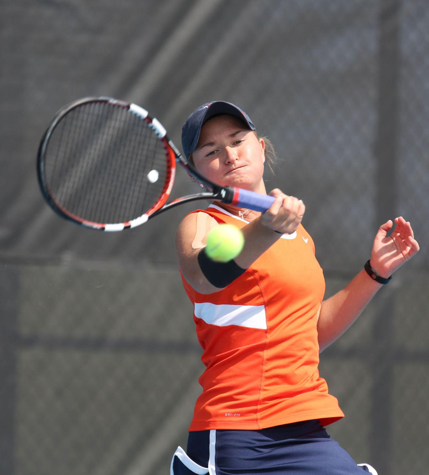 Illinois' Melissa Kopinski attempts to return the ball during the match against Rutgers at Atkins Tennis Center on Sunday. The Illini won 7-0.