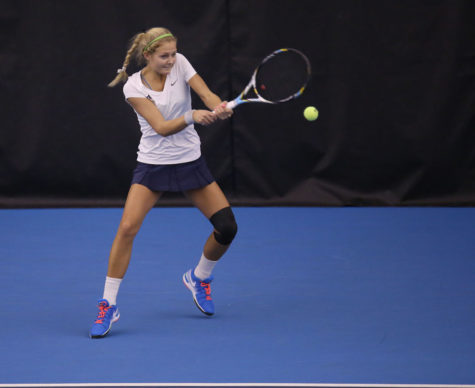 Illinois' Julia Jamieson attempts to return the ball during the match against Indiana at Atkins Tennis Center, on Sunday, March, 1. The Illini won 6-1.