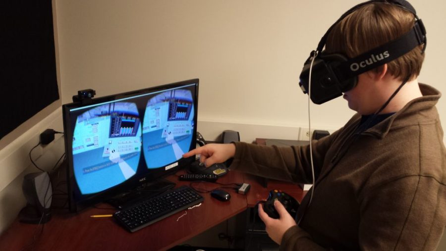 Cory Scribner, senior in Engineering, uses the Oculus Rift virtual reality program to operate devices in a model of a research reactor that was once on campus. His research group, headed by Rizwan Uddin, develops virtual reality programs that can be used in academic and workplace settings.