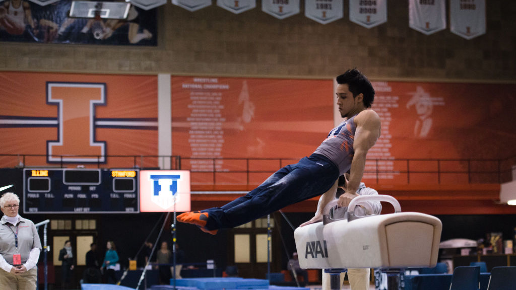 Illinois' C.J. Maestas performs a routine on the pommel horse during the meet against Stanford at Huff Hall on March 6.The Illini lost 21-9.