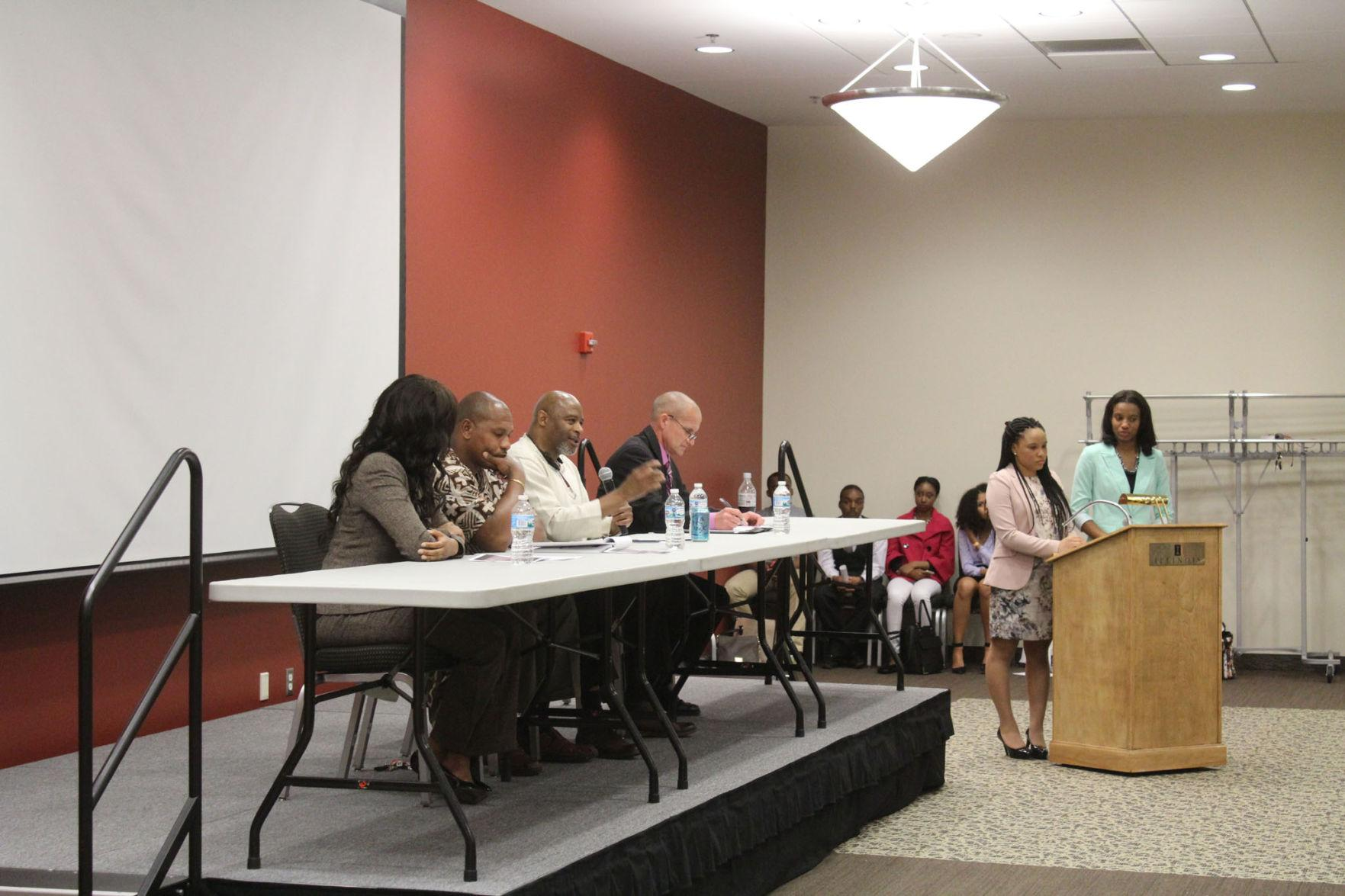 "Panelists Chastidy Burns, Sundiata Keita Cha-Jua, Michael Schlosser and Aaron Ammons respond to a question at the National Association of Black Journalist's event, ""Breaking Brutality."" The event was held to discuss the violent cycle of police brutality."