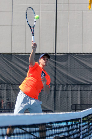 Illinois' Aleks Vukic goes for the smash during the tennis game v. Iowa at Atkins Tennis Center on Saturday, April 11. Illinois won 6-1.
