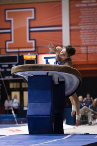 Illinois' Bobby Baker jumps onto the vault during the meet against Stanford at Huff Hall on Friday, March 6.The Illini lost 21-9.