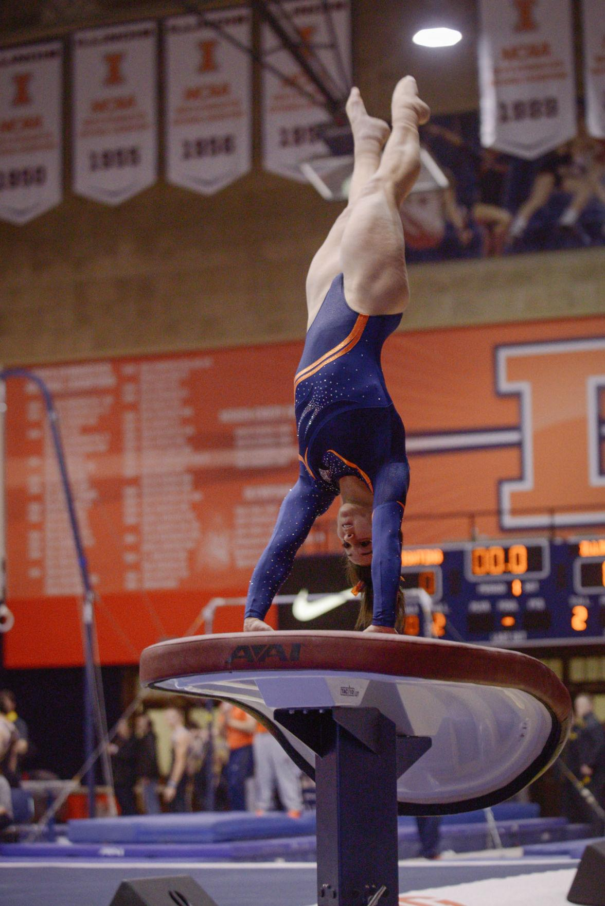 Illinois' Giana O'Connor lifts off from the vault during the meet against Minnesota at Huff Hall on Saturday, Feb. 7. The Illini won 195.775-195.375.
