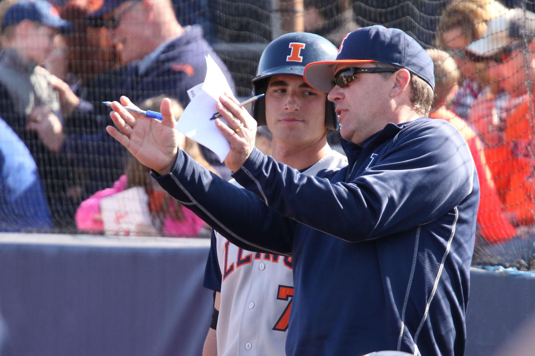 Illinois' head coach Dan Hartleb gives Reid Roper some guidance during the baseball game against Northwestern at Illinois Field on Saturday.