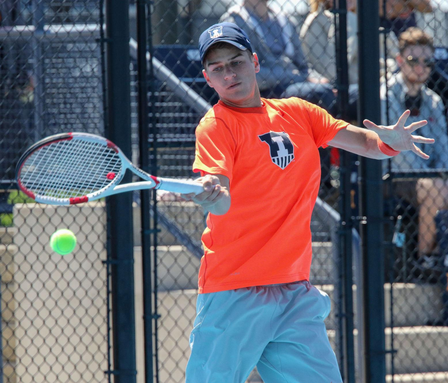 Illinois' Aron Hiltzik makes a return during team's 6-1 winning game against Iowa at Atkins Tennis Center on April 11.