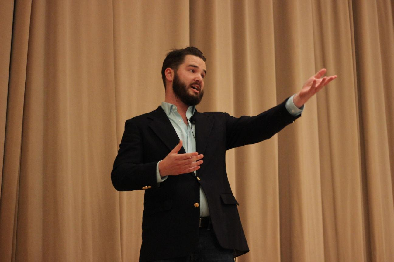 Nick Hyde, Illinois law student, gives a performance at Monday's C-U Comedy Competition at Gregory Hall.