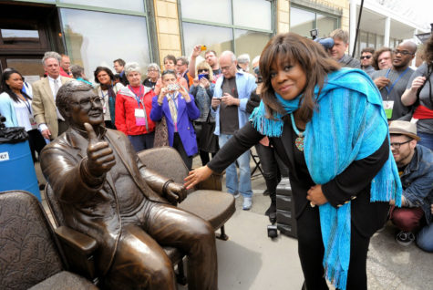 Chaz Ebert touches the hand of the statue of Roger Ebert that was unveiled at Ebertfest last year.