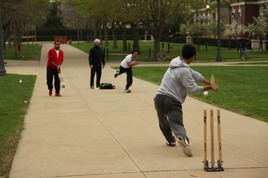 Students play cricket on the South Quad on April 24. Participants are members of the Cricket Club of Illinois, a registered student organization. Cricket tournament finals will be Sunday on the South Quad.