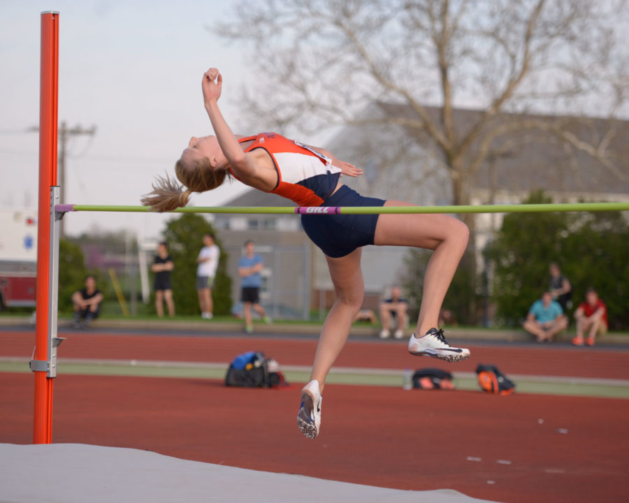 Illinois' Kandie Bloch-Jones leaps over the bar during the high jump event at the Illinois Twilight meet on April 18.
