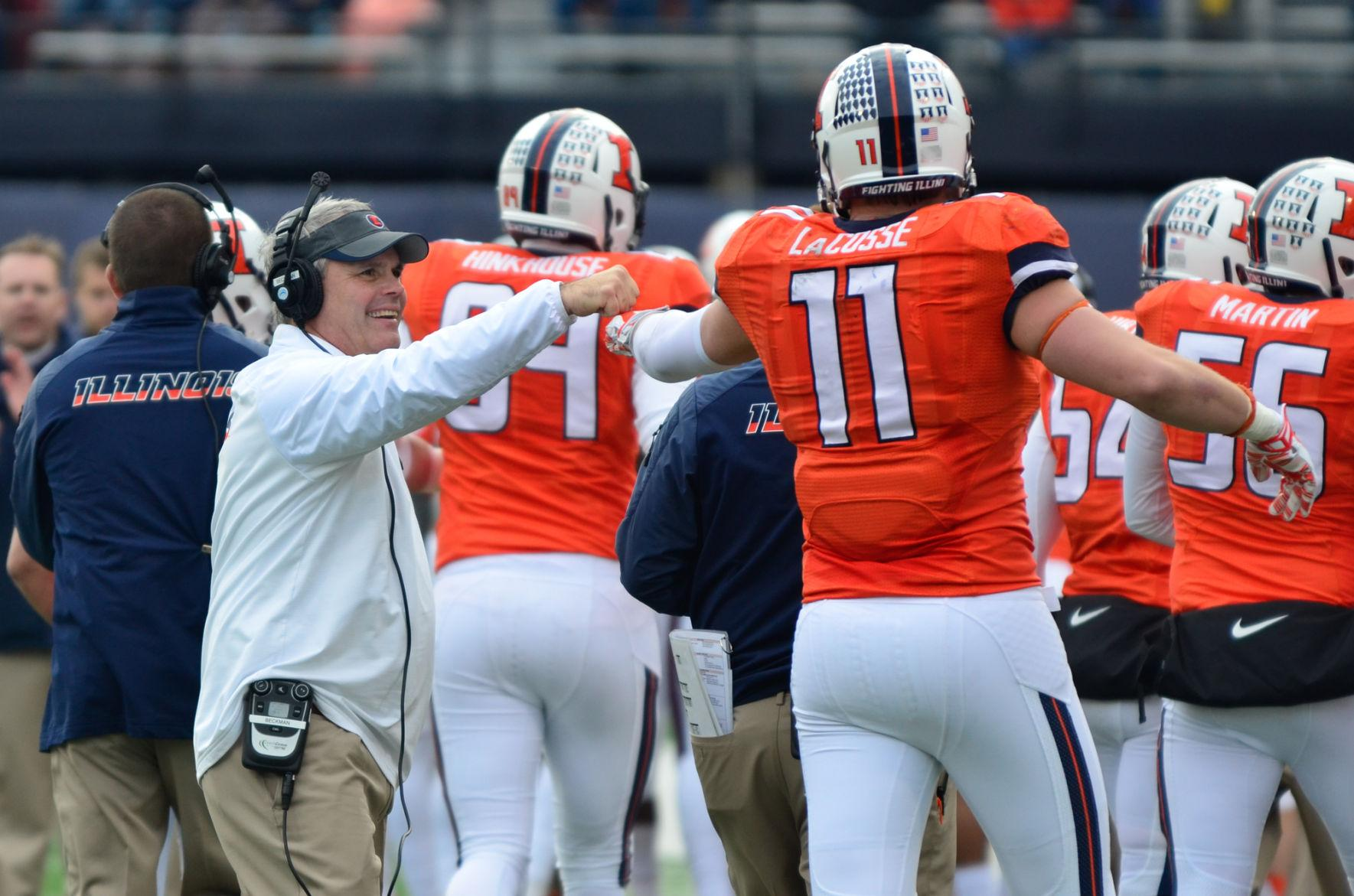 Illinois' head coach Tim Beckman congratulates Matt LaCosse (11) after a touchdown during the team's game against Penn State at Memorial Stadium on Nov. 22, 2014. Several former and current players tweeted out support for Beckman on Thursday.
