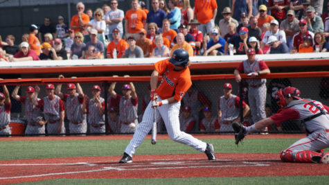 Illinois' David Kerian (12) attempts to make contact with the ball during the baseball game vs. Indiana at Illinois Field on Saturday, April 18. Illinois won 6-3.