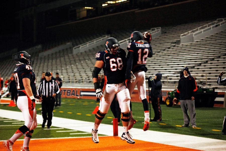 Ryan Lankford (12) and Simon Cvijanovic (68) celebrate after Lankford scores a touchdown at the orange and blue spring scrimmage at Memorial Stadium on April 12, 2013.