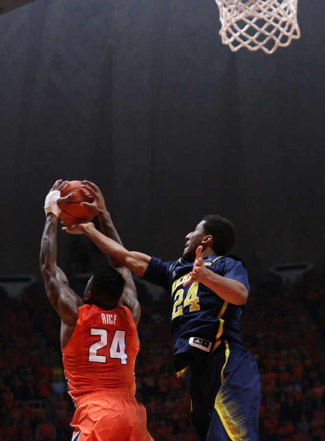 Illinois%27+Rayvonte+Rice+%2824%29+steals+the+ball+from+an+inbound+play+during+dying+seconds+of+the+game+against+Michigan+at+State+Farm+Center%2C+on+Feb.+12%2C+2014.+The+Illini+won+64-52.