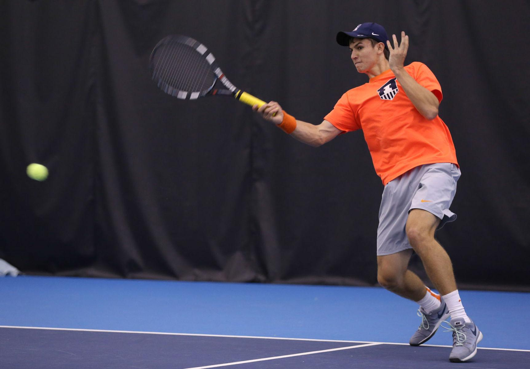 Illinois' Aleks Vukic attempts to return the ball during the match against Ohio State at Atkins Tennis Center, on Sunday, March 29.