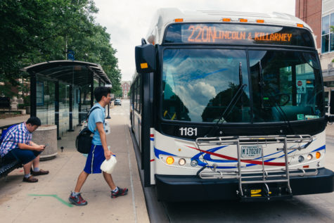 A student boards the 220N bus at the Transit Plaza.