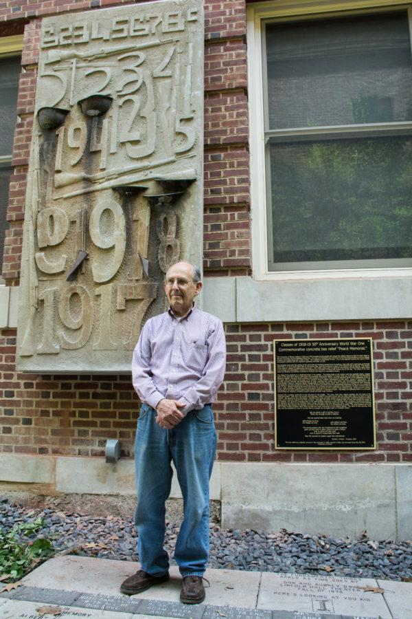 Donald Molnar, sculptor, stands by his recently-remounted Peace Memorial sculpture in the Lincoln Hall courtyard on May 29.