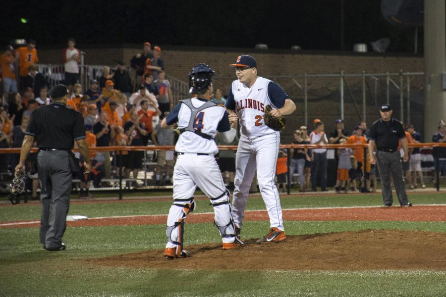Illini+pitcher+Kevin+Duchene+and+catcher+Kelly+Norris-Jones+celebrate+together+on+the+mound+after+defeating+Ohio+at+Illinois+Field%C2%A0on+May+29.