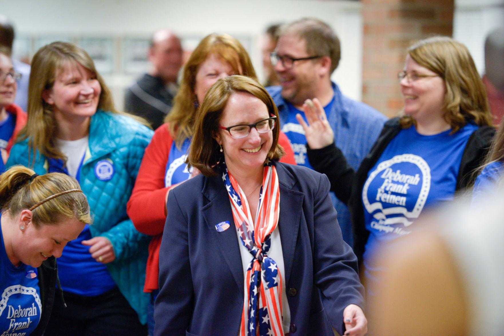 Deborah Frank Feinen smiles as she walks into the room to be greeted by her supporters and interviewed by the media at the Brookens Center on Tuesday.