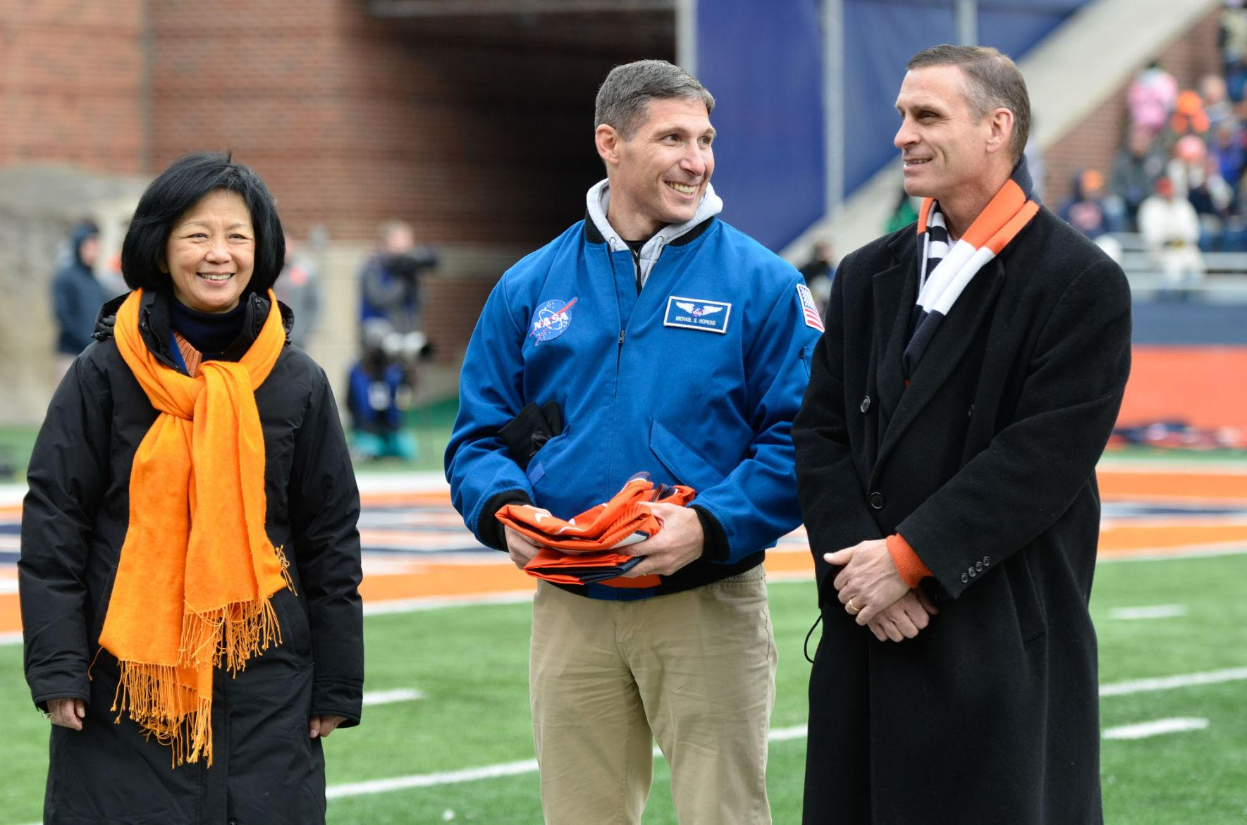 NASA astronaut and former Illini Mike Hopkins presents a jersey and flag to Chancellor Phyllis Wise and Athletic Director Mike Thomas during the game against Iowa at Memorial Stadium on Saturday, Nov. 15, 2014. Thomas responded Monday to Simon Cvijanovic's Twitter accusations of Tim Beckman.